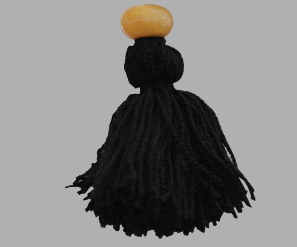 Disponible avec des pompons et perle jaune